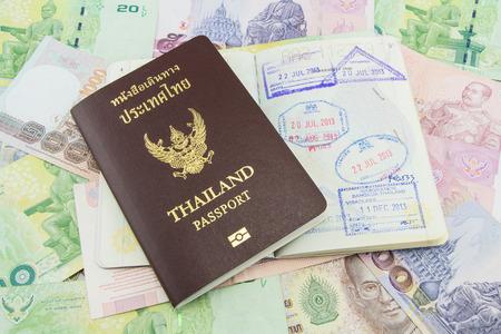 Thailand Passport on Thailand Banknotes photo