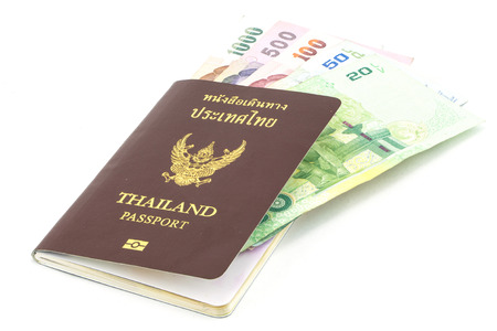 Thailand Passport and Thailand Banknotes photo