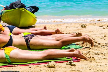 Many women sunbathing, Mahya bay, Krabi Thailand Stock Photo