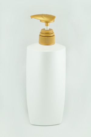 gels: White plastic bottles for cosmetic creams, lotions, shampoo and gels with colored caps