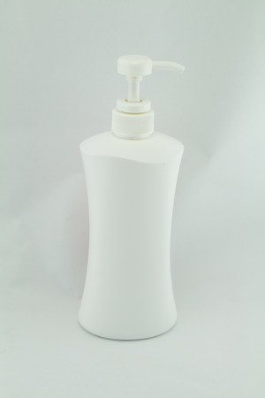 colored gels: White plastic bottles for cosmetic creams, lotions, shampoo and gels with colored caps