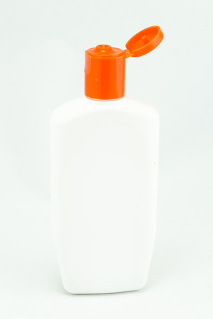 White plastic bottles for cosmetic creams, lotions, shampoo and gels with colored caps