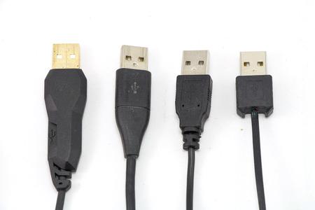 Many USB cable on white background isolated photo