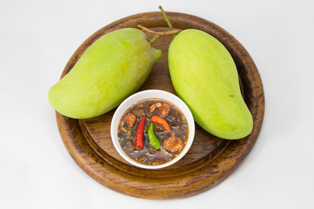 Set of green mangoes with Sweet fish sauce photo