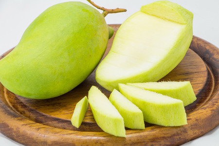 thinness: Fresh Green mango isolated on white;