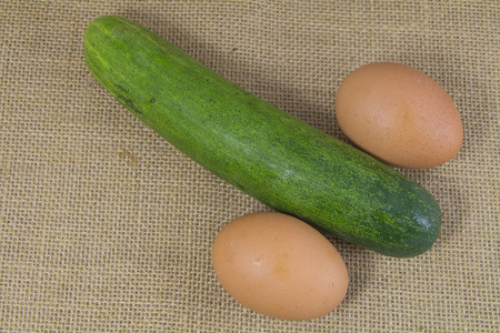 pecker: cucumber and egg look like penis on sack Stock Photo