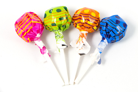 paleta de caramelo: Lollipop del caramelo de colores sobre fondo blanco