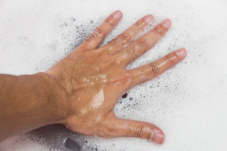 soapy water: Hand washing clothes with soapy water Stock Photo