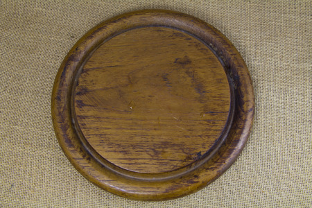 wooden block: Circle wooden block on sack background