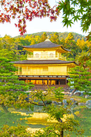 rokuonji: Kinkakuji or Rokuonji Temple autumn leaves changing color HDR Color mood Editorial