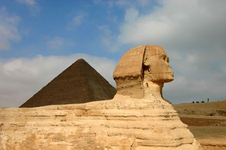 Giza sphinx with pyramids on the background. Egypt.