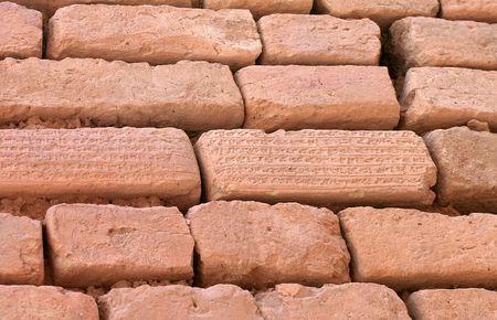 Brick wall with cuneiform writing on bricks. Shoqa Zanbil near Shush, Iran