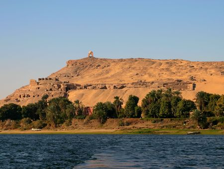 Mausoleum and ruins on Nile bank on the hill near Aswan. Stock Photo