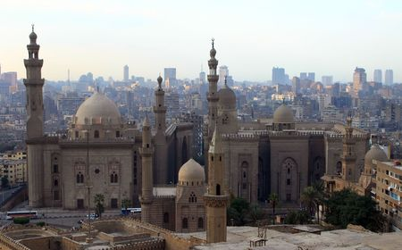 Mosque of Sultan Hasan and cityscape of Cairo taken from Citadel (Mohammed Alis Mosque). Egypt Stock Photo