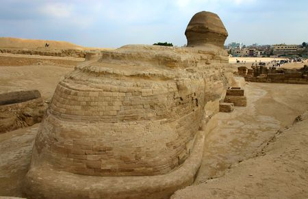 Back view of the sphinx next to pyramidsin Giza. Cairo. Egypt