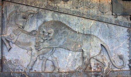 Lion and deer on bas-reliefs of Persepolis, Iran