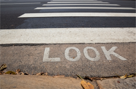 Pedestrian crossing (zebra) with word look in front of it.