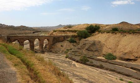 Aqueduct (qanat) in deserted village of Kharanaq near Yazd. Iran Stock Photo