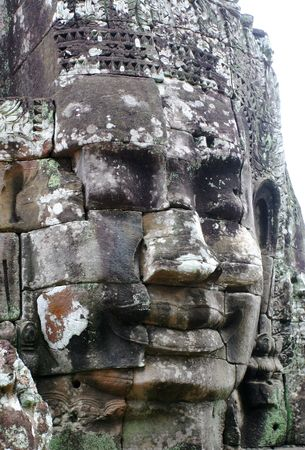 Close-up of smiling face of the king Jayavarman VII  in the temple of Bayon, Angkor Wat, Siem Riep, Cambodia. Stock Photo