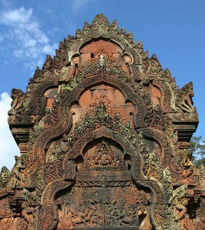 Red stone carving of the Banteay Srei Temple in the Angkor. Siem Reap, Cambodia.
