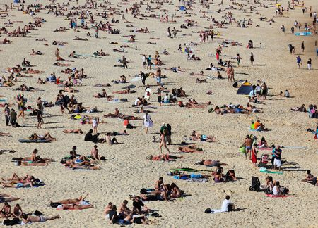 SYDNEY, AUSTRALIA - November 1, 2009: Sydney, Australia: The first hot summer day. People are taking sunbath on Sydney famous Bondi Beach. Editorial
