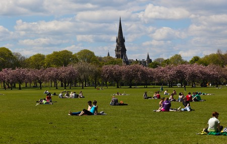 central european: EDINBURGH – May 2010. The first nice spring day in year. People are taking sunbath in The Meadows Park. May 18 2010 in Edinburgh. Scotland. UK.