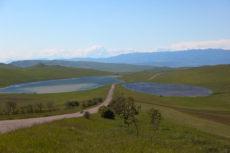Meadows, country road and two lakes near David Gareja cave monastery. Kakheti. Georgia. photo