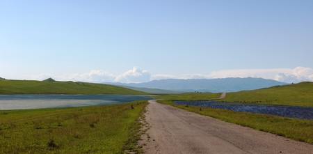 Meadows, country road and two lakes near David Gareja cave monastery. Kakheti. Georgia. Stock Photo - 8209917