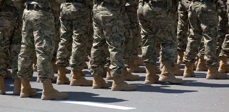 Legs of soldiers in military uniform and boots. Tbilisi. Georgia. photo