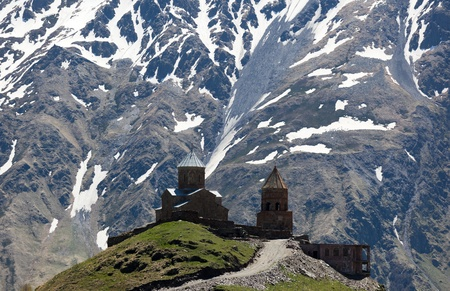 Gergeti Trinity Church and Caucasus Mountains, near Stepantsminda (formerly Kazbegi). Georgia.