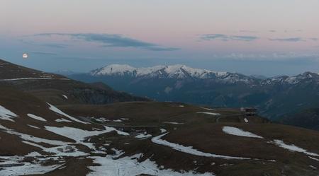 View of Caucasus Mountains, moon and Russian Georgian friendship monument from near Jvari (Krestovy, Cross) Pass. Khevi region. Georgia. Stock Photo - 8624593