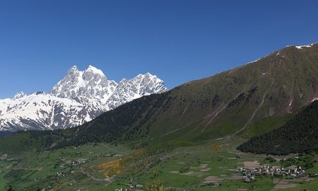Double peaks of Mt. Ushba and Mulakhi Village. Svaneti. Georgia. Stock Photo - 9059799