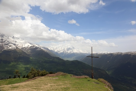 mestia: Summit marked with cross above Mestia village. Upper Svaneti. Georgia.