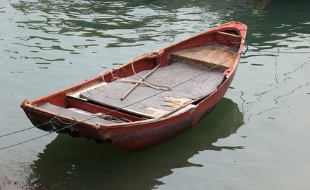 Old moored dinghy. Cheung Chau. Hong Kong. photo
