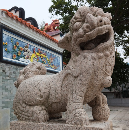 Lion in front of the entrance to Pak Tai Temple.  Cheung Chau. Hong Kong. photo
