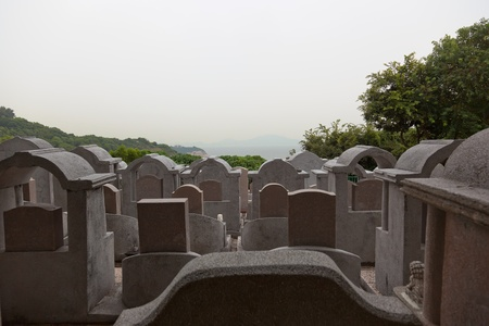 Traditional Cemetery on Cheung Chau Island. All the graves directed towards ocean. Hong Kong.