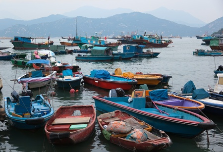 Late evening. Fishing and house boats in Cheung Chau harbour. Hong Kong.