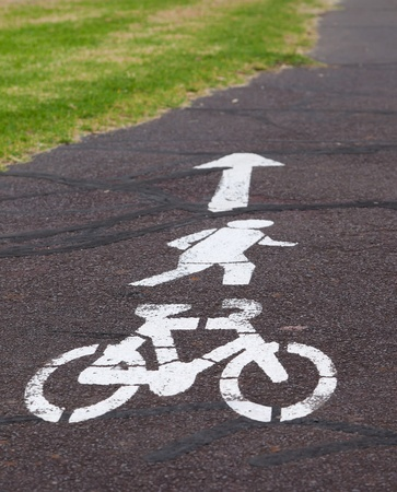White bicycle track sign painted on the road. Melbourne. Australia. photo