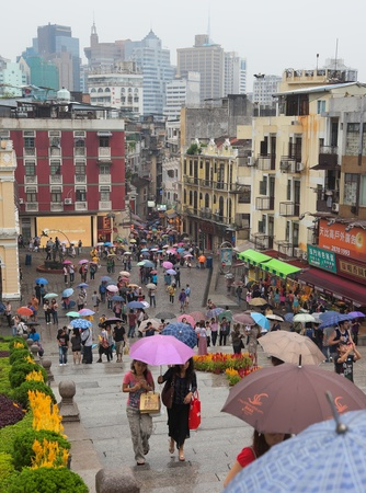 People under colourful umbrellas. Rainy day. Macau. China. Editorial