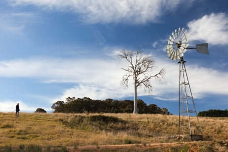 A rural landscape with windmill  Near Oberon  New South Wales  Australia  Stock Photo