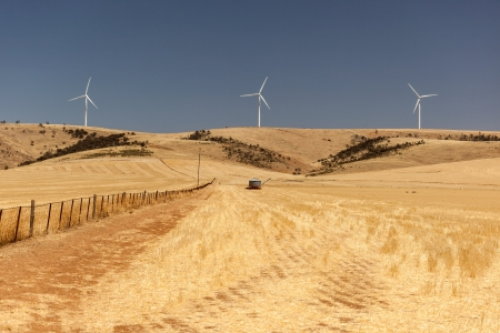 Rural landscape with wind generators distorted by hot air  South Australia Stock Photo - 19575698