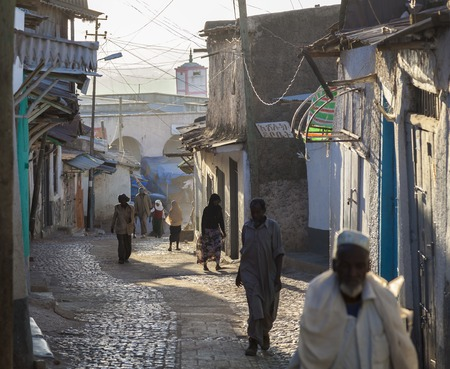 HARAR, ETHIOPIA - DECEMBER 23, 2013  Unidentified people of ancient walled city of Jugol in their morning routine activities that almost unchanged in more than four hundred years