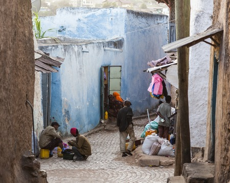 HARAR, ETHIOPIA - DECEMBER 23, 2013  Unidentified people of ancient walled city of Jugol in their daily routine activities that almost unchanged in more than four hundred years