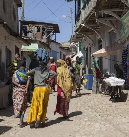 than: HARAR, ETHIOPIA - DECEMBER 24, 2013  Unidentified people of ancient walled city of Jugol in their daily routine activities that almost unchanged in more than four hundred years