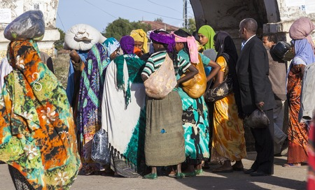 HARAR, ETHIOPIA - DECEMBER 24, 2013  Unidentified people of ancient walled city of Jugol in their daily routine activities that almost unchanged in more than four hundred years