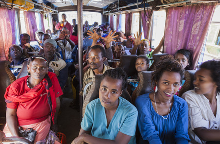 ethiopian: SODO WOLAITA. ETHIOPIA - DECEMBER 26, 2013: Unidentified people on the bus waiting for departure. Buses in Ethiopia leave when full, not according to timetable.