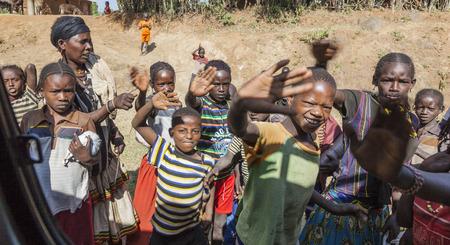 ARFAIDE (NEAR KARAT KONSO). ETHIOPIA - DECEMBER 26, 2013: Unidentified Ethiopian children in small village. Despite government efforts to fight poverty it is still widespread in Ethiopia.