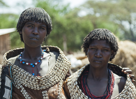 WEITA. OMO VALLEY. ETHIOPIA - DECEMBER 29, 2013: Traditionally dressed unidentified women from Tsemay tribe. Most Omo Valley people maintain their traditional way of life.