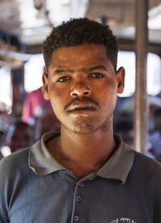 ethiopian ethnicity: SODO WOLAITA. ETHIOPIA - DECEMBER 26, 2013: Portrait of unidentified man on the bus. Buses in Ethiopia leave when full, not according to timetable. Editorial