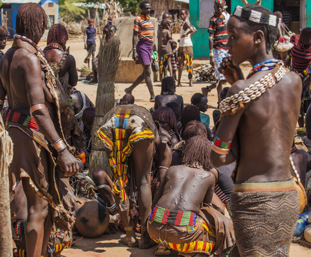 TURMI, OMO VALLEY, ETHIOPIA - DECEMBER 30, 2013: Unidentified Hamar people at village market. Weekly markets are important events in Omo Valley tribal life.